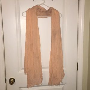 Peachy colored scarf
